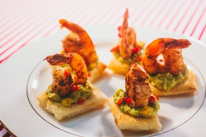 Spicy Shrimp with Avocado-Corn Salsa on a Toast point