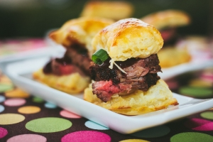 Beef Tenderloin Bites on a Flaky crostini topped with a raspberry chipotle demi