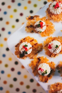 Parmesan Crisp with Goat Cheese Mousse, garnished with Balsamic Drizzle and peppers