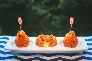 Twisted Deep fried Meatballs topped with a tangy peach bourbon chutney